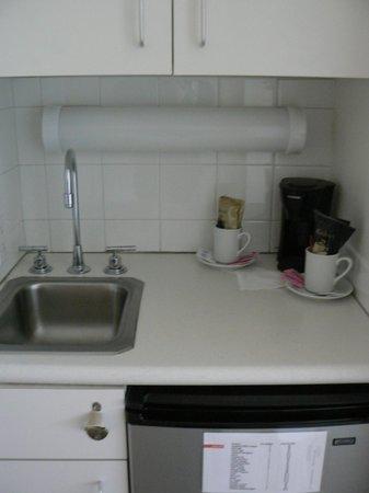 Heat Hotel: Coffee pot/ fridge/ microwave above