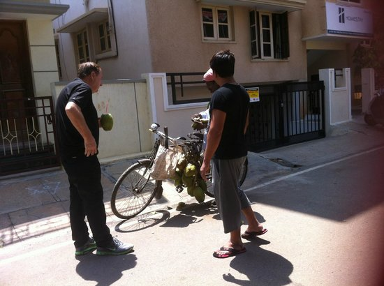 Homestay Serviced Apartments : Buying coconuts from an selling from his bike