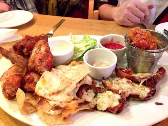 Loaded Hog shared starter. Ribs, wings, nachos, potato ...