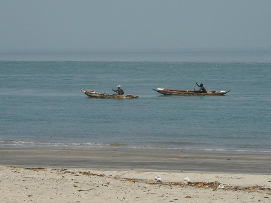 Laico Atlantic Banjul Hotel: Local boats paddling by...