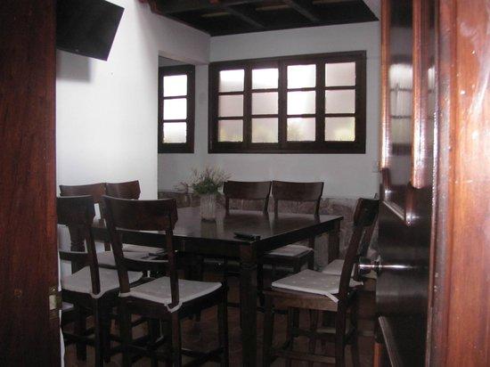 President House Hotel: comedor con tv