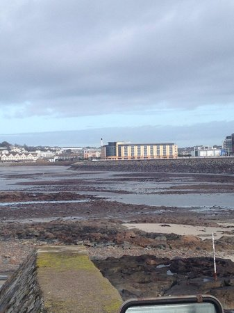 Radisson Blu Waterfront Hotel, Jersey: View of the hotel from Elizabeth Castle (tide out!)