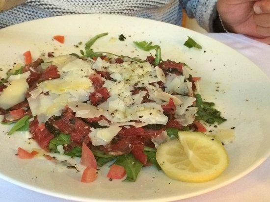 Alpino cucina e vino: starter capaccio with fresh herbs