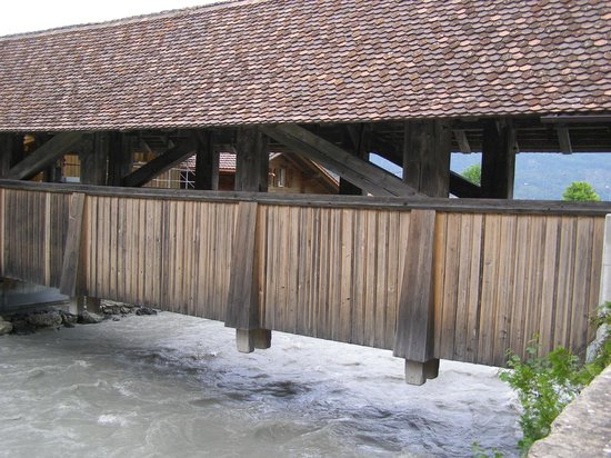 Gasthaus Steinbock: Very old wooden bridge next to hotel Steinbock