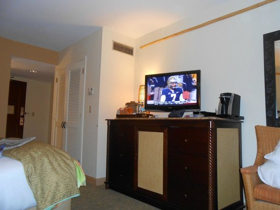Loews Royal Pacific Resort at Universal Orlando: room with tv, coffee maker, and fridge