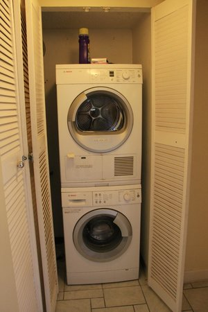 Chateau By The Sea : Small front load laundry units inside the condo #305