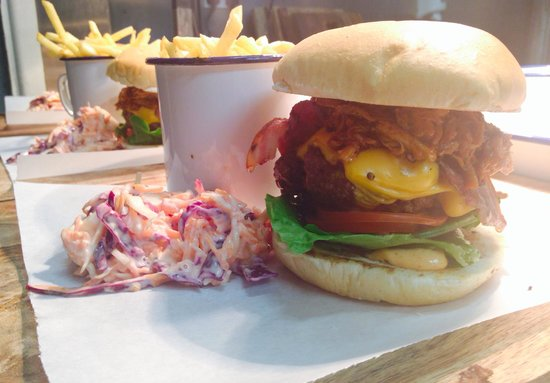 GPT Smokehouse: The GPT Dirty Burger topped with American cheese, smoked bacon and 16 hour smoked pulled pork x