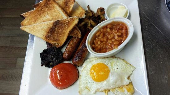 Mim's restaurant : Full english breakfast heinz baked beans honey roast pork sausages, bacon and toast from uk too,