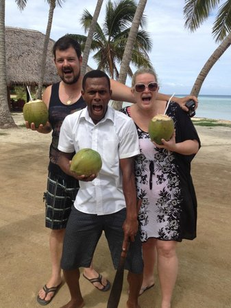 Tropica Island Resort: Ice climbed the tree and got us some fresh coconuts :)