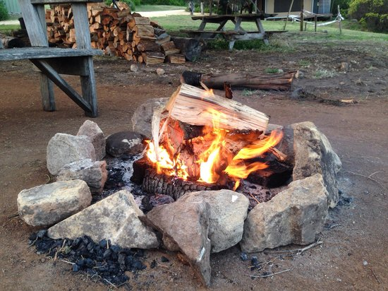 Pebble Point: Camp fire next to kitchen and meals area