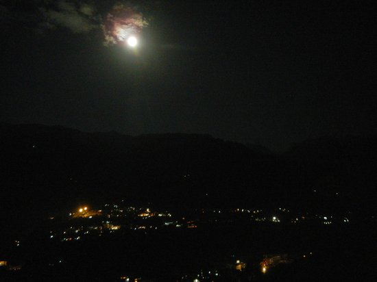 The Holiday Resorts Cottages & Spa: View of the Valley from room balcony on a full moon night.