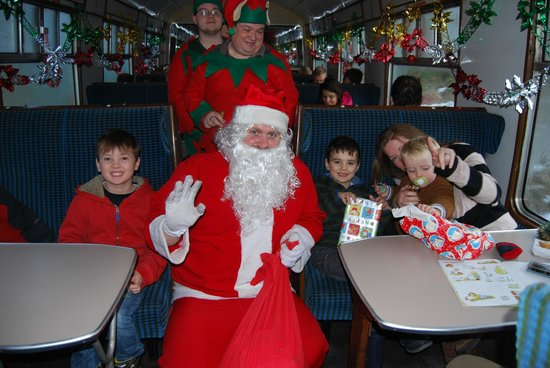 Strathspey Steam Railway: Santa and the elves welcome their guests with presents