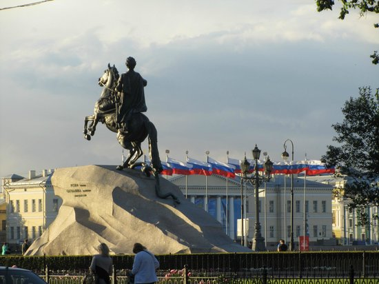 Bronze Horseman, Monument To Peter I: Bronze horseman: in the background line of Russian flags and thunderstorm clouds (summer 2013)