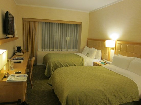 Orchard Garden Hotel : room with very comfortable beds
