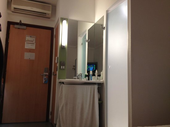 Hotel ibis budget Portsmouth: sink area with shower to right and toilet compartment behind