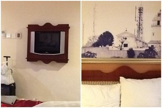 Guia Hotel : lcd tv and headboard on the bed