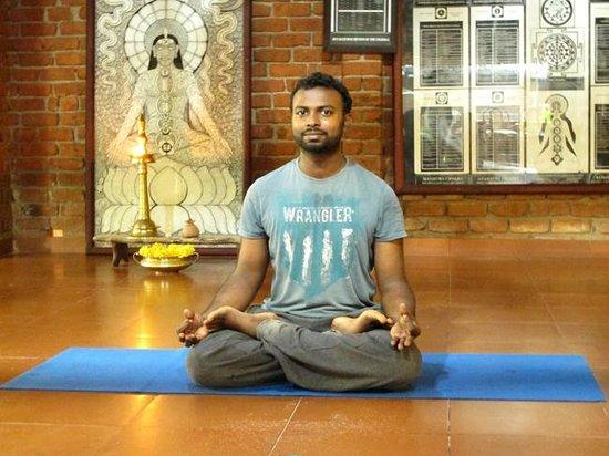 Somatheeram Ayurveda Resort: One of three daily yoga instructors of the resort