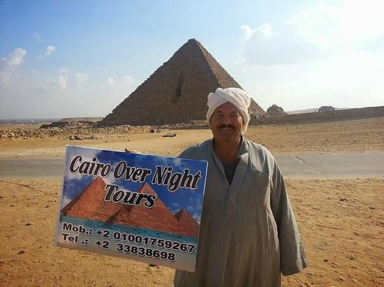 Cairo-Overnight Tours: Happy Smile from one of our Local friends at giza Pyramids