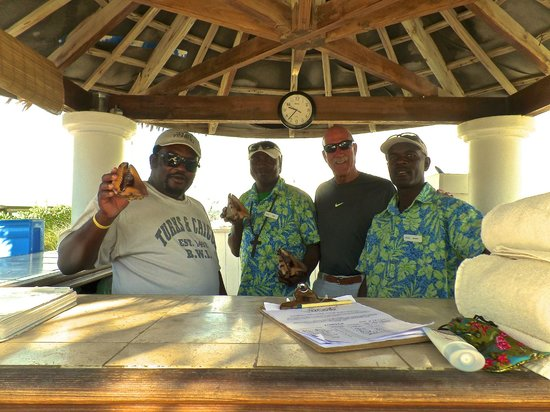 Sands at Grace Bay: Big John, Berthold, myself and Eddy. The awesome beach services staff!