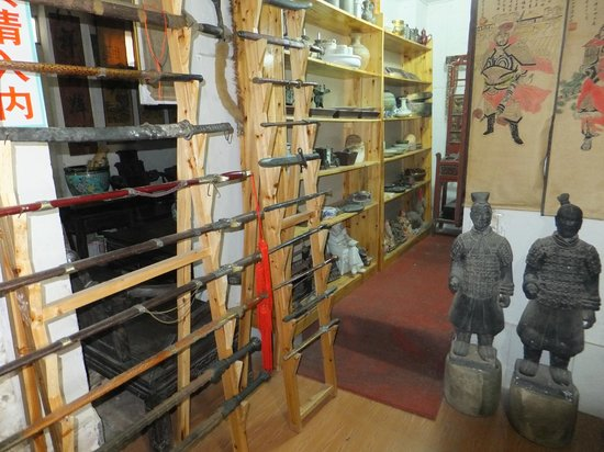 Hakka Culture Village of Yongding: A mixture of Chinese & Japanese swords in the antique shop
