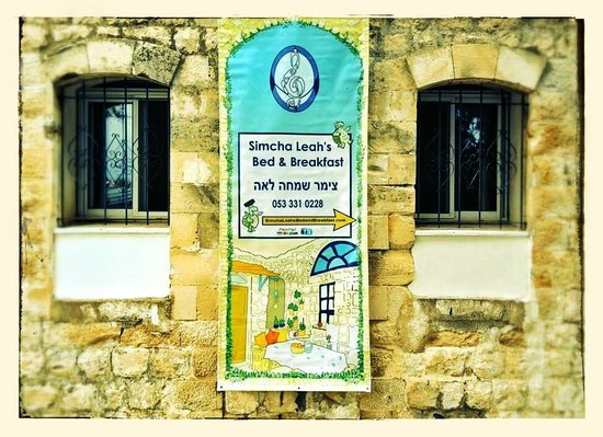 Simcha Leah's Bed and Breakfast: Poster advertising our B&B, on the outside wall of the property