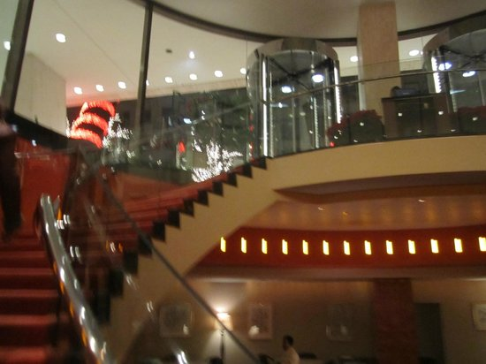 Brasserie 8 and a Half: Entrance to Brasserie 8 1/2 and winding staircase down to restaurant