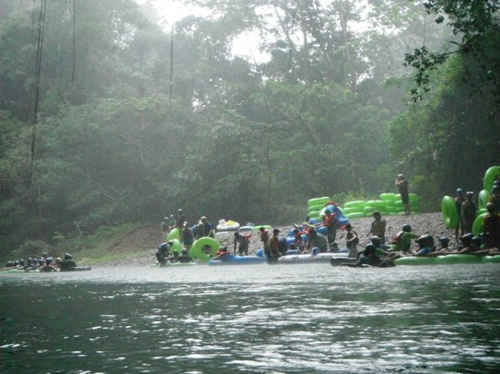 Butts Up Cave Tubing: Coming out of our first cave, seeing the Carnival excursion people getting in for the second cav