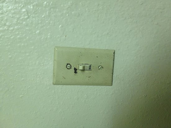 Super 8 Sterling CO : Dirty switch plate.
