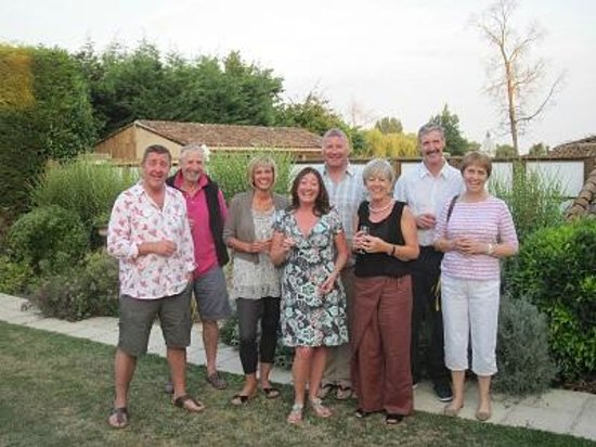 Loire Wine Tours - Day Tours: Guests at Manoir de Gourin enjoying an aperitif before dinner on the terrace