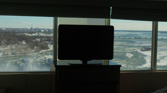 Radisson Hotel & Suites Fallsview: the TV and behind the falls view at room 1039