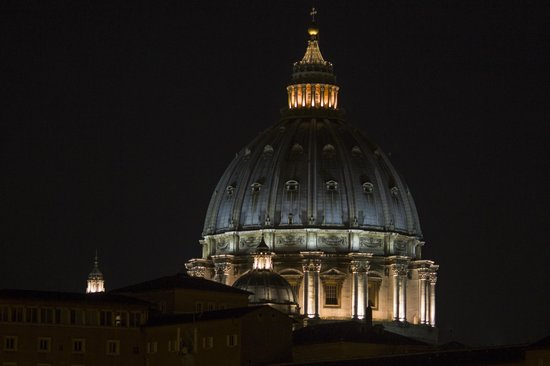 A View of Rome: St. Peter's dome at night, as seen from the room