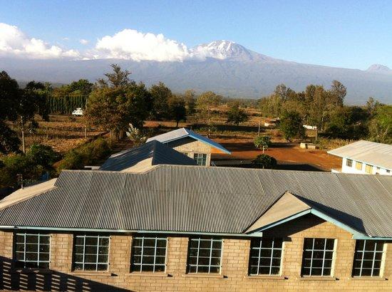 Stella Maris Lodge : Room's balcony view of Mt. Kilimanjaro and Mailisita School (foreground)