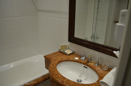 Golden Tulip Hotel Washington Opera: Recently refurbished marble bath (sink/vanity).