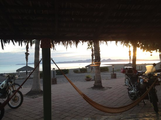 Hotel Oasis: The view at sunset from inside the room, notice the hammocks!