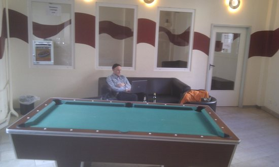 All In Hostel: A Pool table, a cool dude and a smoking room.