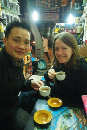 Vietnam Awesome Travel - Day Tours : Tony and Rebecca drinking weasel poo coffee