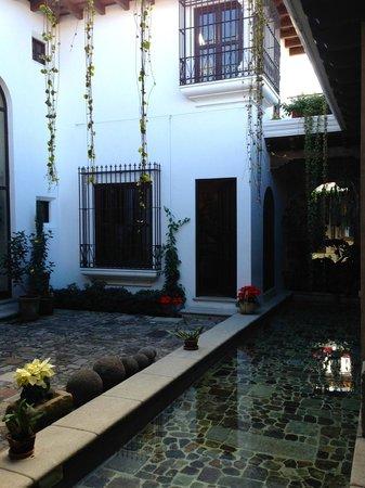 The San Rafael Hotel: King premier suite courtyard