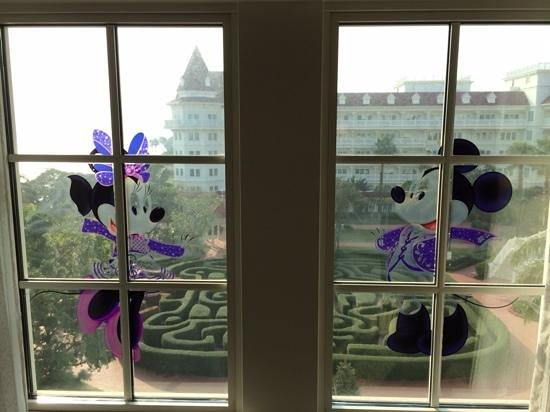 Hong Kong Disneyland Hotel : disneyland stickers on window frame, maze in garden and sea view on far left