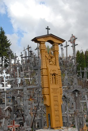 Siauliai Hill of Crosses: New and weathered crosses side by side