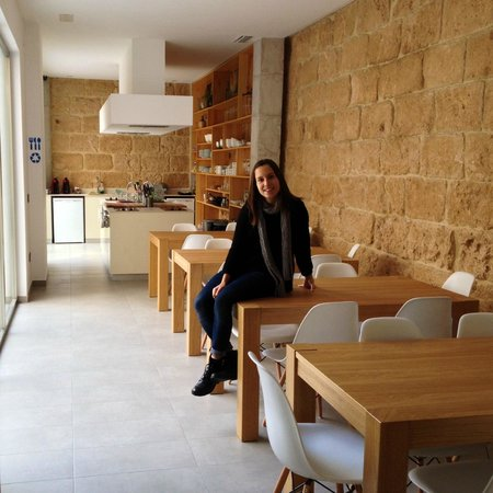 Youth Hostel Jávea: Sitting places and kitchen in the background
