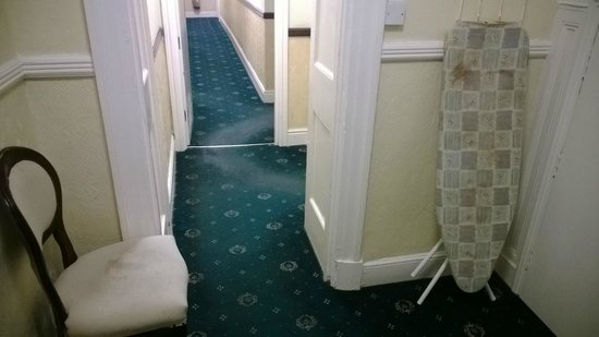 The George Hotel: Ist floor landing and ironing board - DO NOT USE!