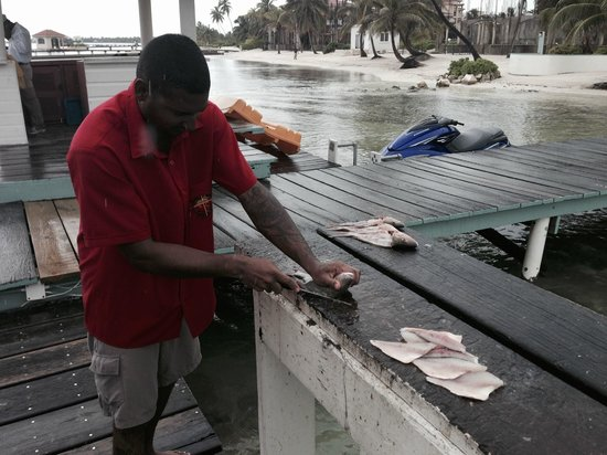 Belizean Shores Resort : Our guide prepares our catch for us to cook at home.
