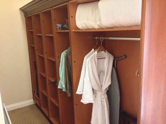 The Malton Hotel: The HUGE closet - 2 hanging areas, many cubby holes, pants press, iron & board, full length mirr
