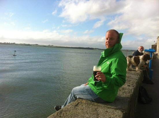 The Anglesey Arms: Enjoying a pint on the seawall.