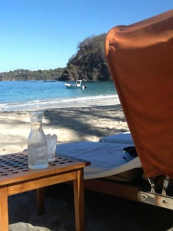 Four Seasons Resort Costa Rica at Peninsula Papagayo: Beach lounge chair with served carafe of cold water.