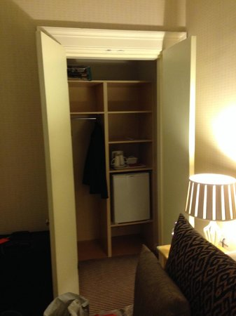 Kew House: Spacious closet, with a mini fridge.