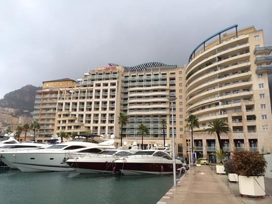 "Riviera Marriott Hotel La Porte de Monaco: From the marina walkway. Double ""Family Rooms"" are in the wavy balcony section in the center."