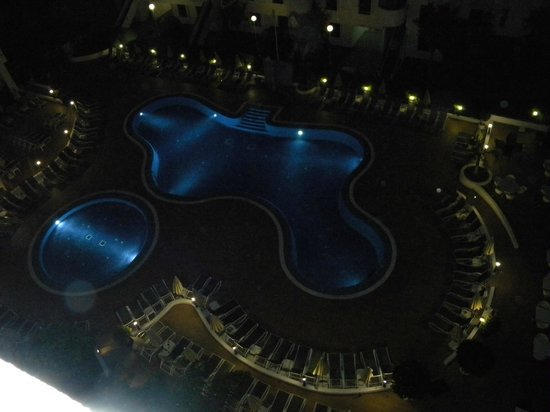 Sunprime Coral Suites: Pool area at night from our room