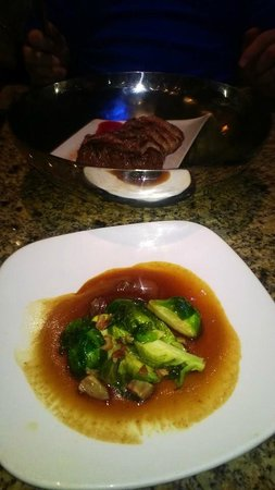 Baked Alaska : Steak & Brussels sprouts, meat served with smoking rosemary...:)