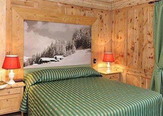 Hotel Alpina: Accogliente suite